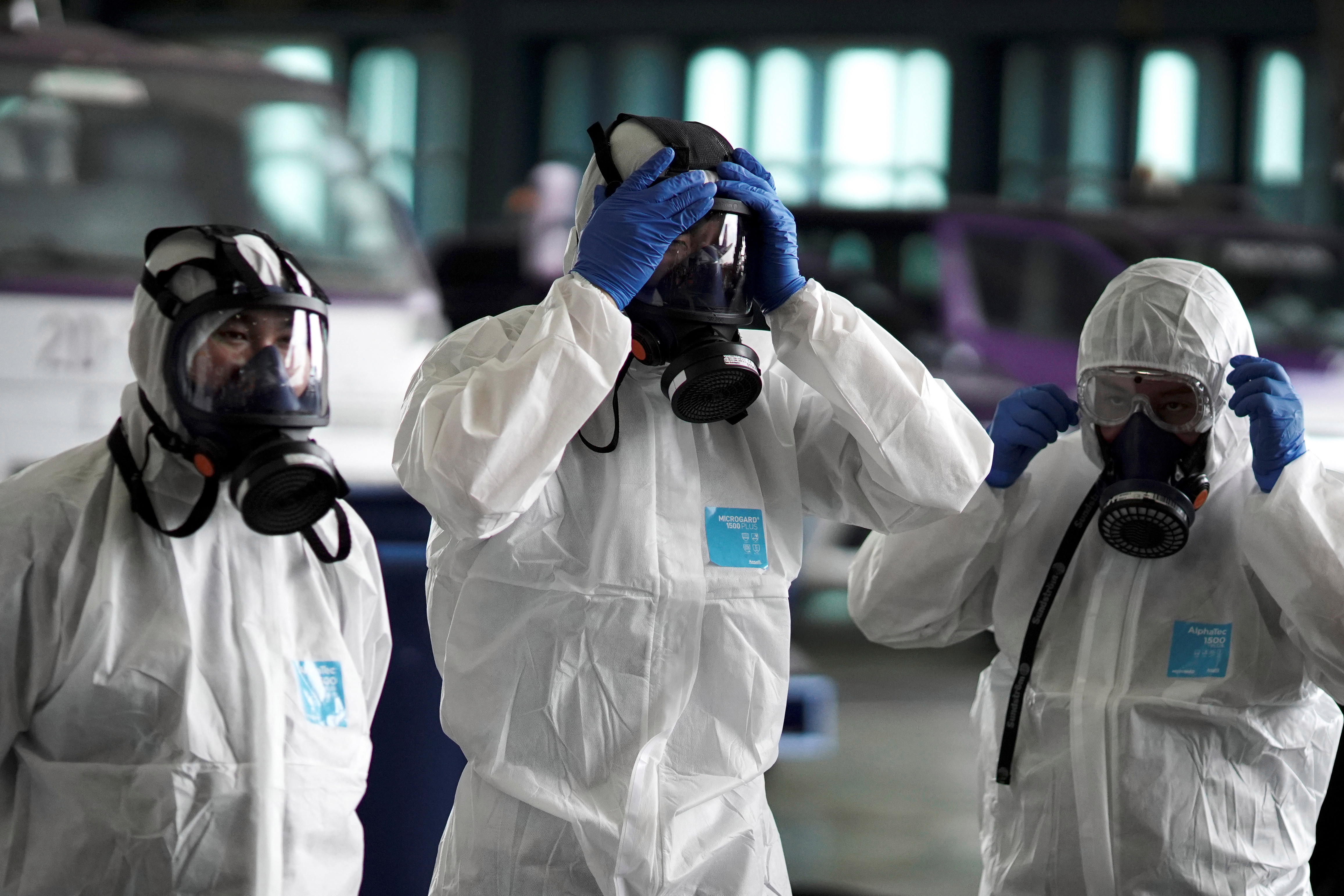 Three people have caught the deadly coronavirus outside of crisis-hit China, image shows Thai Airways workers in hazmat suits as they disinfect a plane