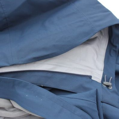 This photo shows the zip off hood on the Stio Environ Jacket.