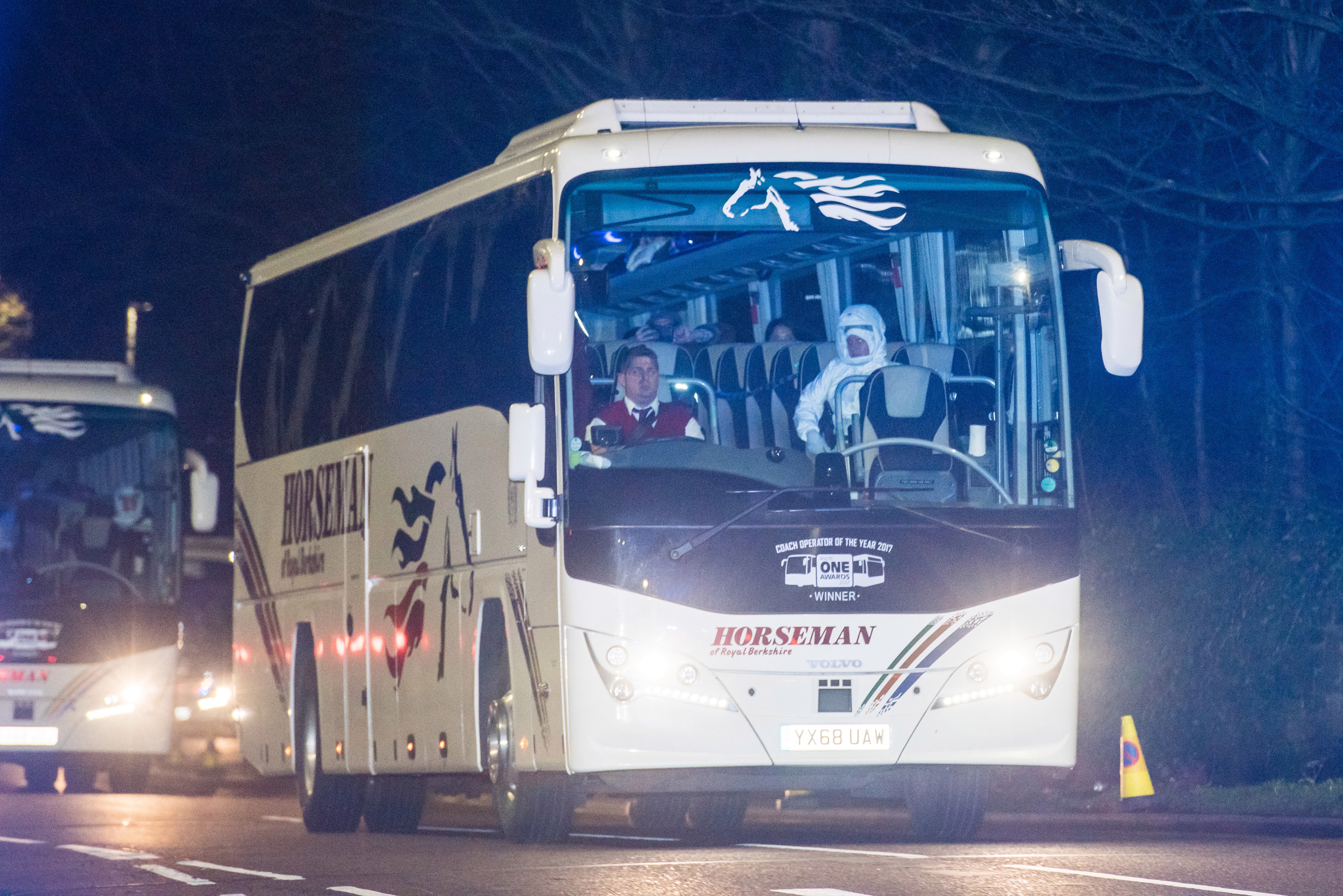 A bus carrying passengers evacuated from coronavirus-hit Wuhan arrives at Arrowe Park Hospital