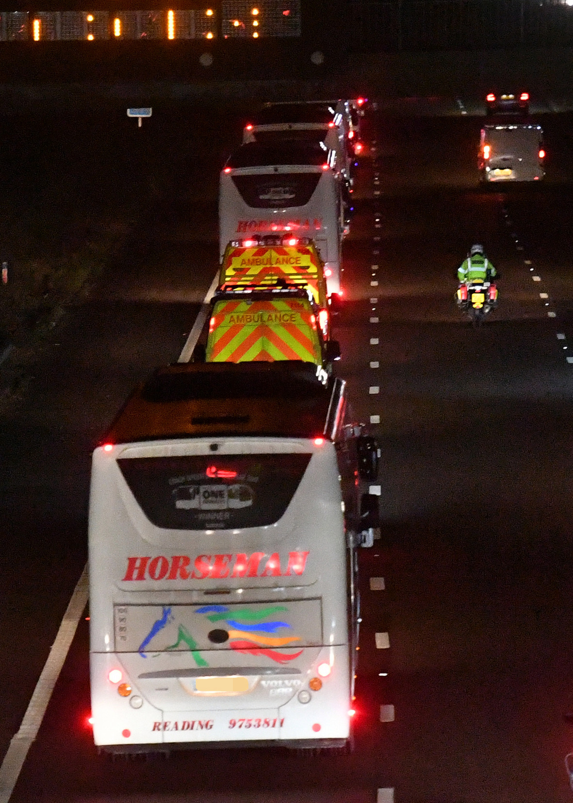 Ambulances joined the convoy of buses on their way to Arrowe Park Hospital