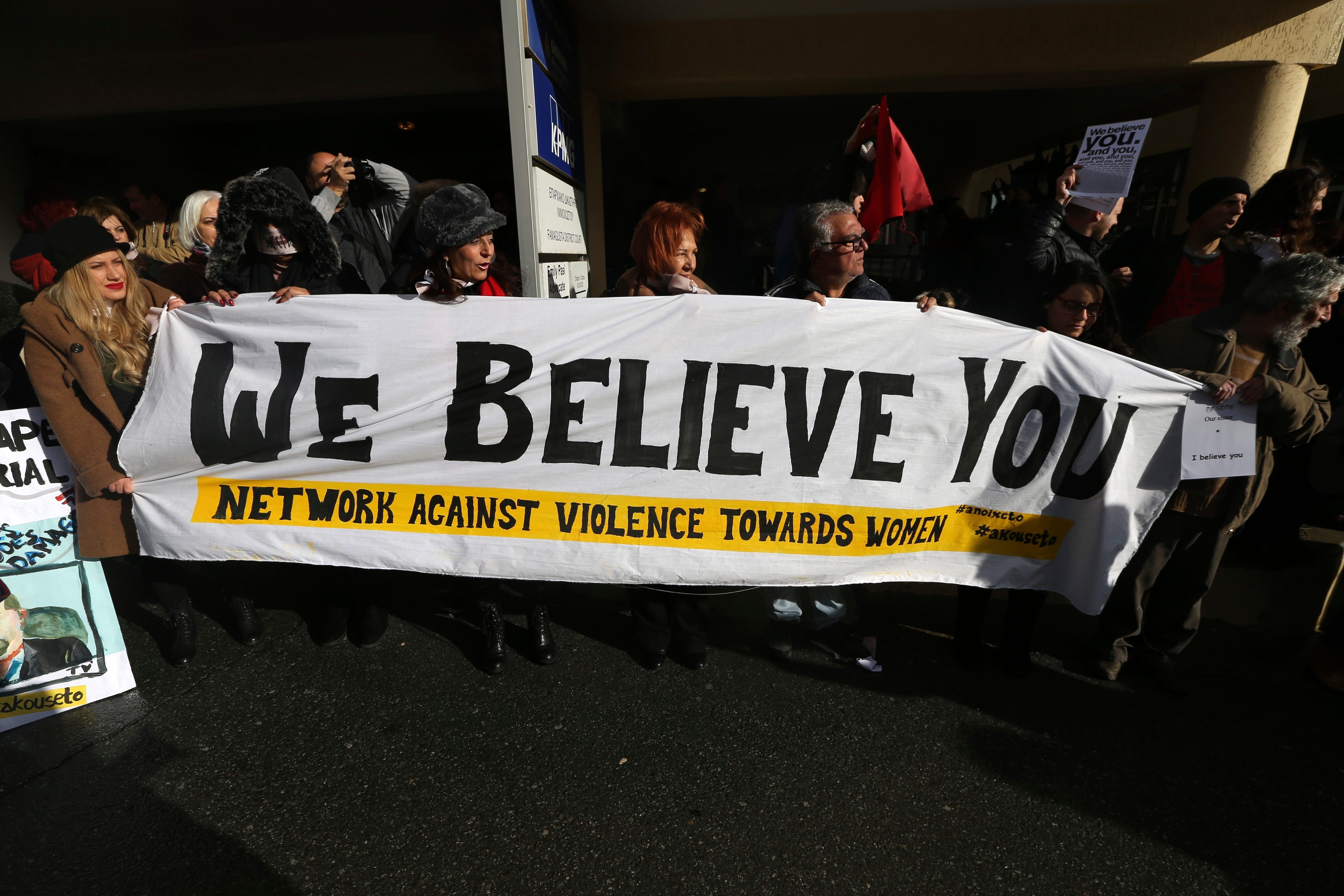 Supporters held signs saying 'We Believe You' and chanted 'You are not alone'
