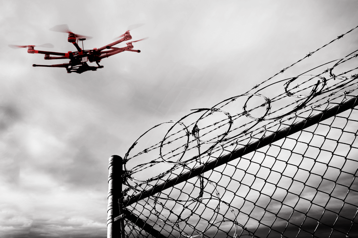 Drone Flying Over Security Fence