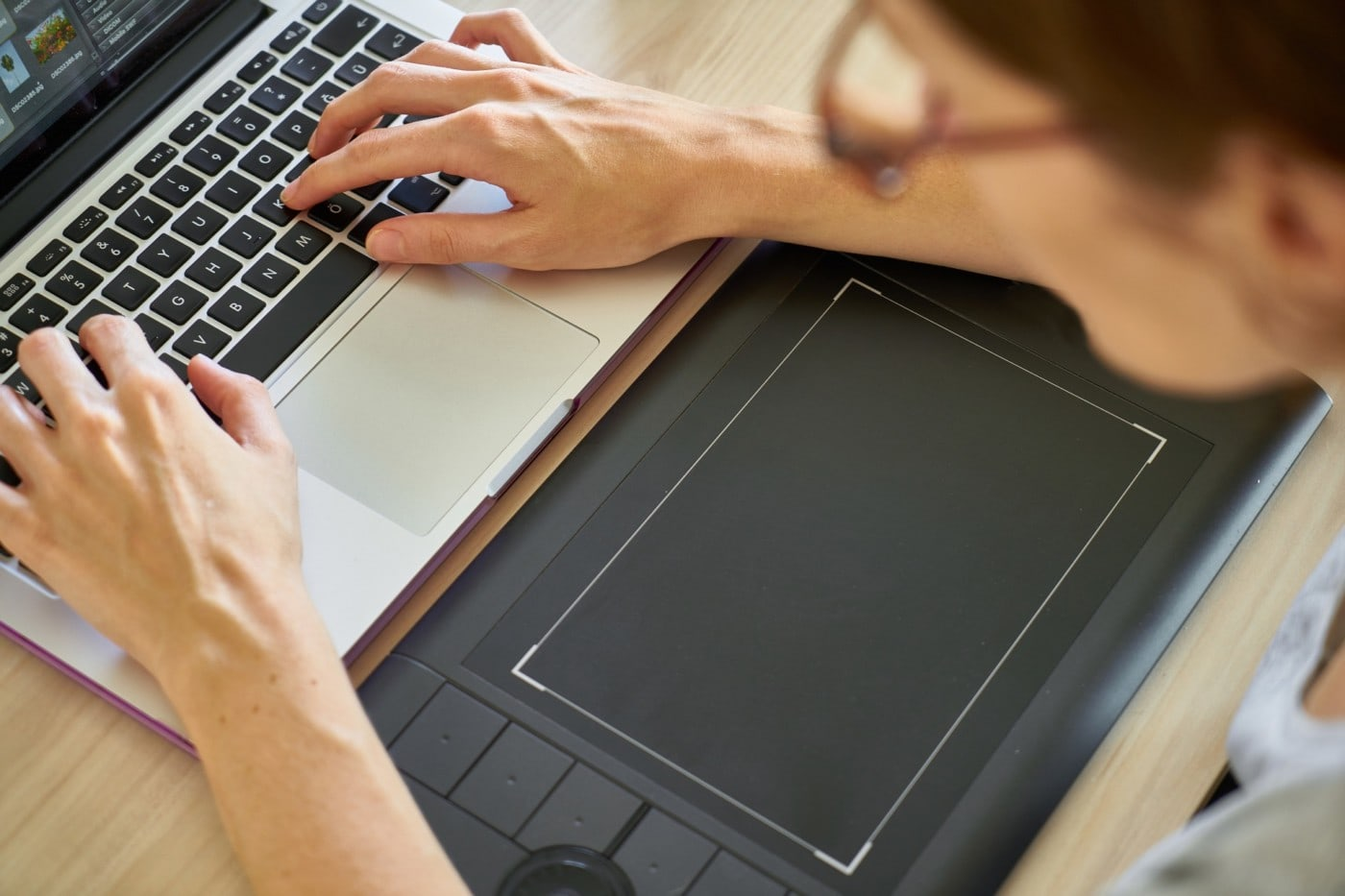 student web designer working on tablet and computer