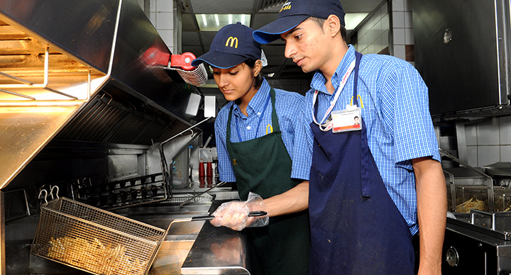 mcdonalds employees showing how to cook the perfect fries
