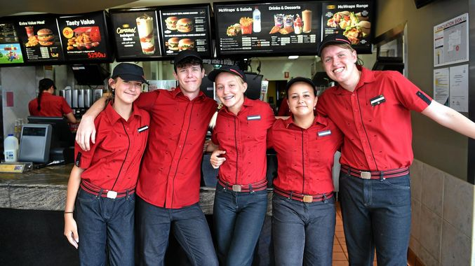 mcdonalds employees happily working together