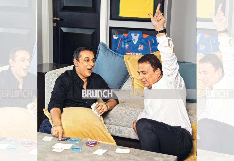 Sunil Gavascar signs with his son Rohan in a new card game called Qwicket.
