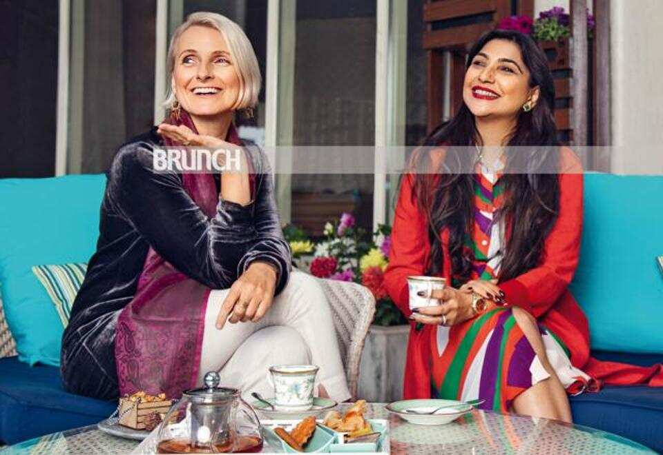 The author of the cover of this HT brunch, Shunali (right), communicates with Gilbert about a floating cup of masala tea.