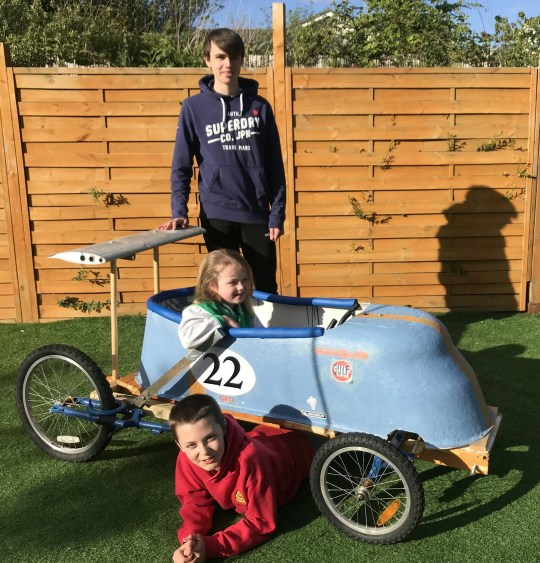 Brothers and sisters showing the bath they were go-karting in.