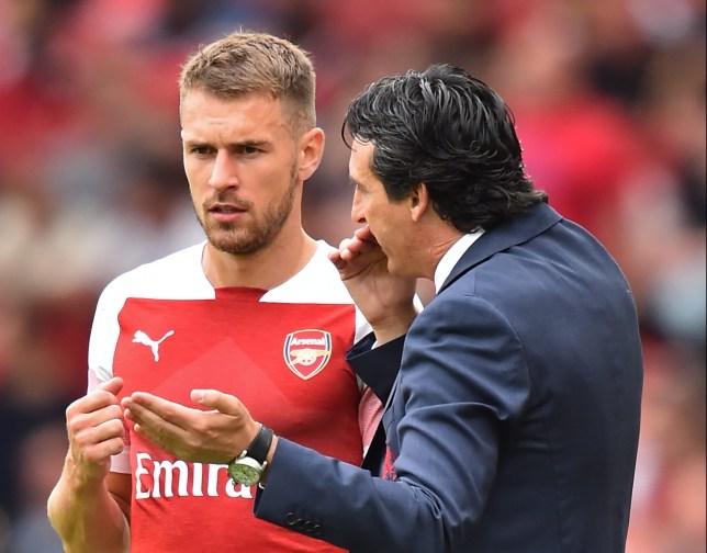 Former Arsenal midfielders Aaron Ramsey and Unai Emery.