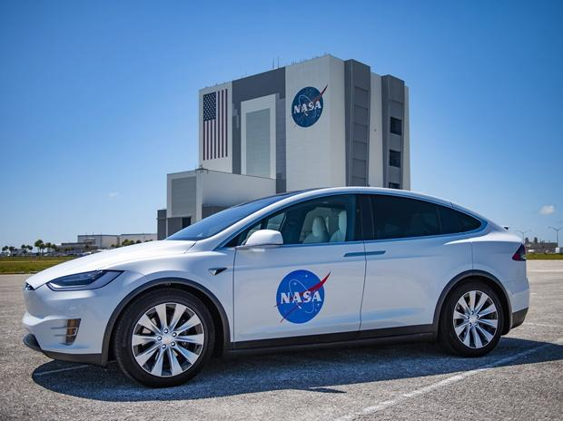 The astronauts arrived on the launchpad about three hours before the launch in Tesla Model X Sports Car