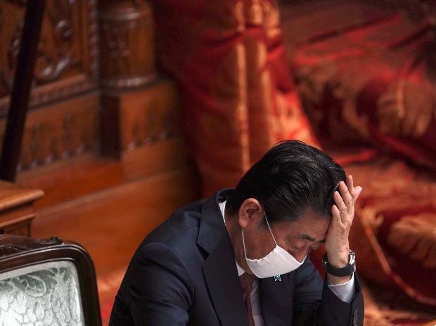 The Japanese Prime Minister Shinzo Abe wears a mask during a plenary session in the upper house of parliament in Tokyo.