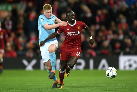 Sadio Mane of Liverpool is challenged by Kevin De Bruyne of Manchester City during the UEFA Champions League Quarter Final Leg One match between Liverpool and Manchester City at Anfield on April 4, 2018 in Liverpool, England.