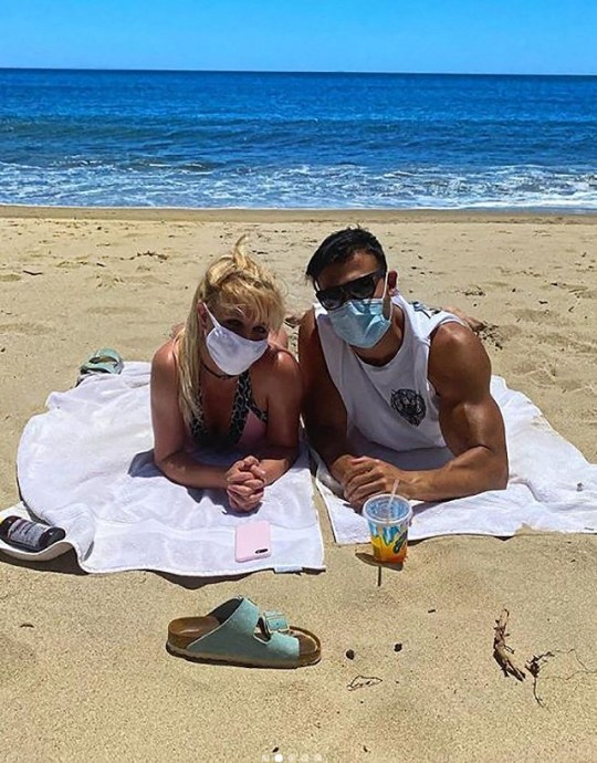 Britney disguised as a beach date with Sam Asgari Photo: britneyspears METROGRAB