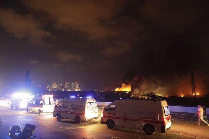 India Tv - Ambulances drive past the site of a massive explosion in Beirut, Lebanon, Tuesday, Aug. 4, 2020. (AP
