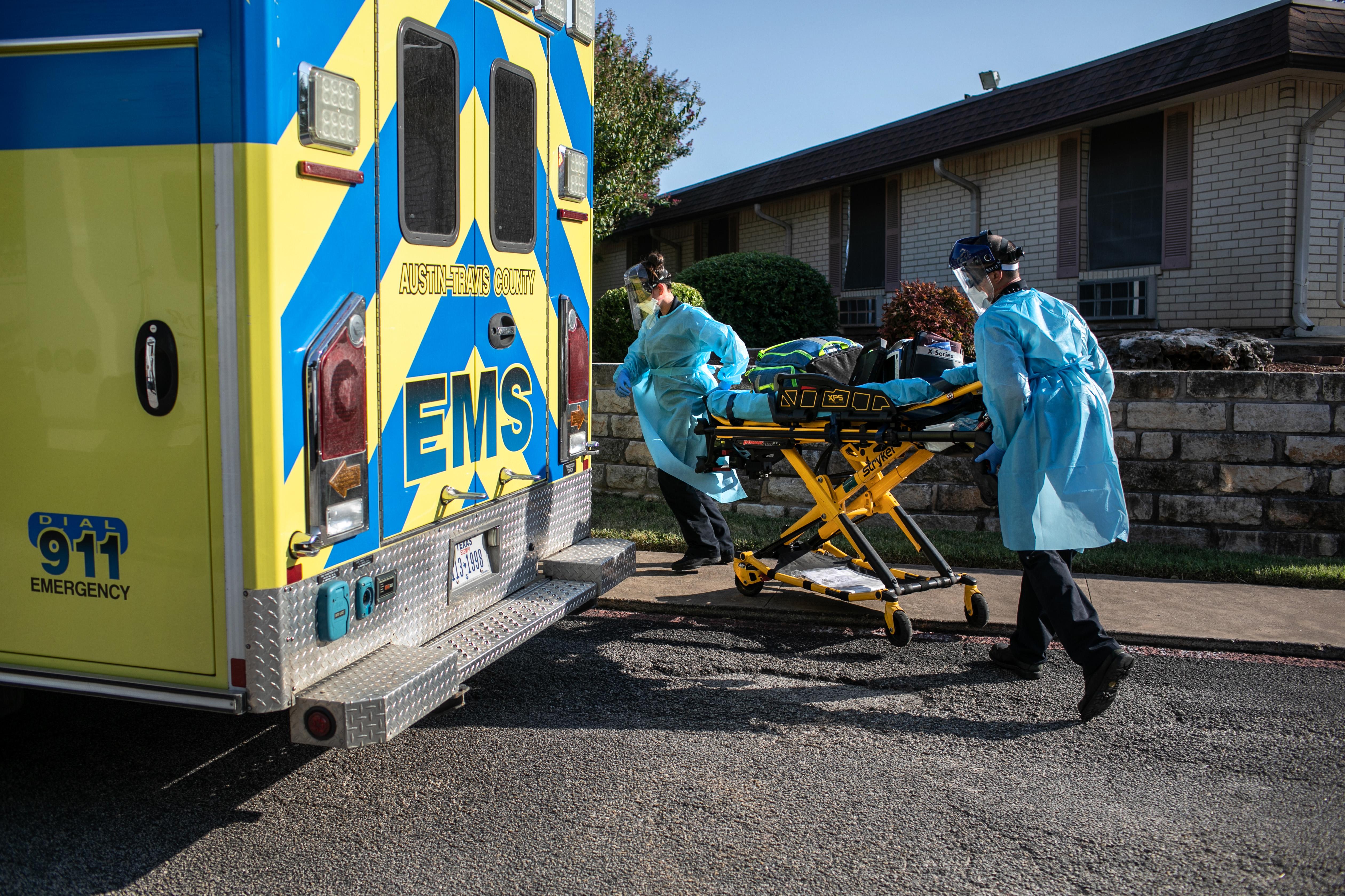 Austin-Travis County medics prepare to enter a nursing home on August 5 in Austin, Texas.