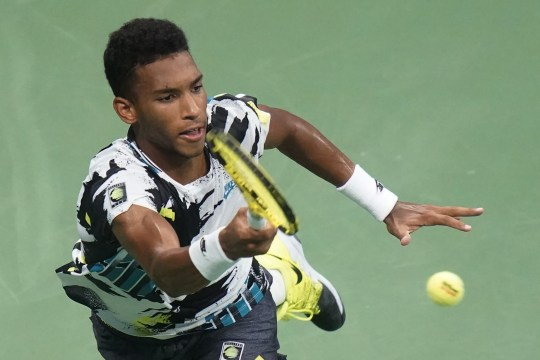 Felix Auger-Aliassime, of Canada, returns a shot to Andy Murray, of Great Britain, during the third round of the U.S. Open tennis championships, Thursday, Sept. 3, 2020, in New York. (AP Photo/Frank Franklin II)