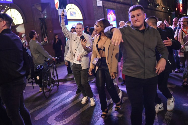 LONDON, ENGLAND - SEPTEMBER 12: People are seen dancing in Soho on September 12, 2020 in London, England. From Monday, September 14, groups of more than six will be banned from meeting under new coronavirus restrictions. (Photo by Peter Summers/Getty Images)