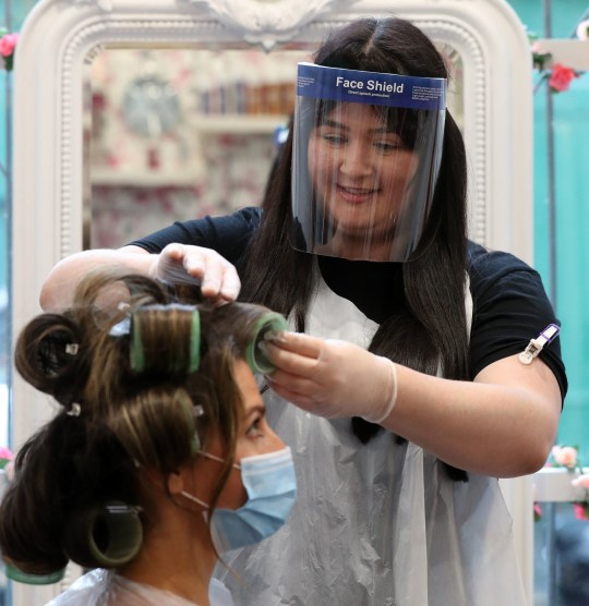 Salon manager Gemma Inglis works on the hair of Shireen Inglis at The Lunatic Fringe in Glasgow as they demonstrate some of the changes put in place to help protect against coronavirus. Hairdressers across Scotland are preparing to reopen to customers on Wednesday as lockdown measure are eased. PA Photo. Issue date: Monday July 13, 2020. See PA story SCOTLAND Coronavirus Hairdresser. Photo credit should read: Andrew Milligan/PA Wire