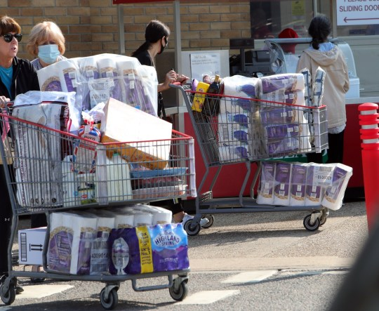 Shoppers stockpile toilet paper outside a Costco in September