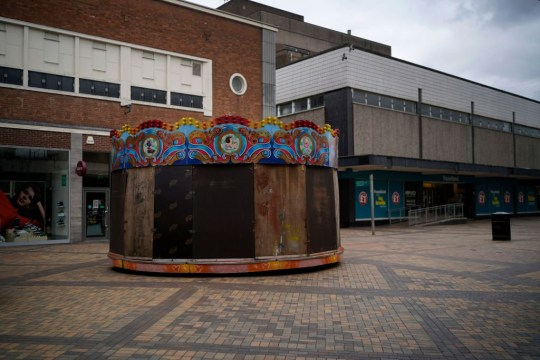 A boarded up children's carousel sits dormant during the pandemic lockdown and closure of shops, restaurants and businesses on April 01, 2020 in Stockport, United Kingdom. The Coronavirus (COVID-19) pandemic has spread to many countries across the world, claiming over 40,000 lives and infecting hundreds of thousands more.