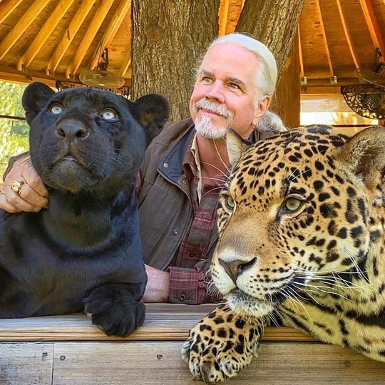 Doc Antle pictured with black panther and leopard