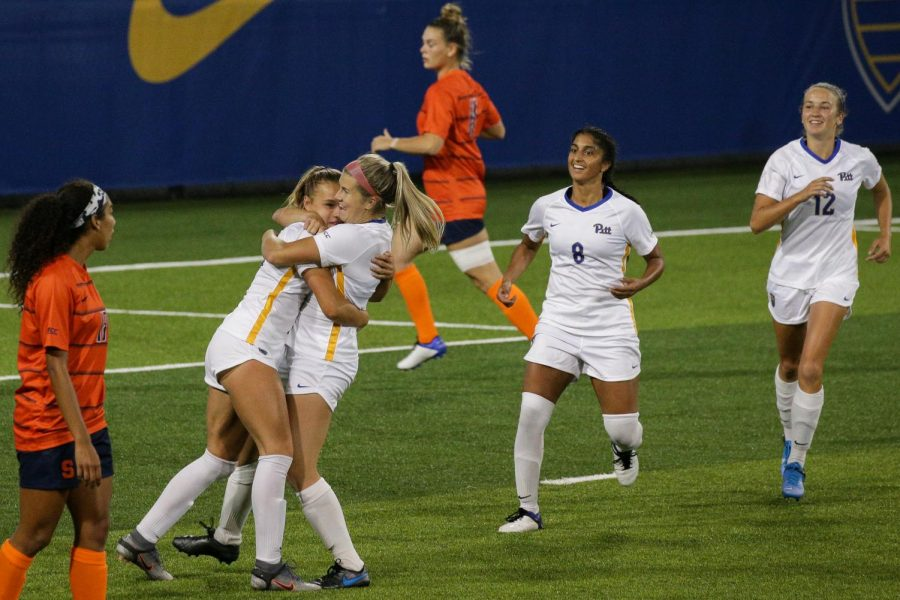 Sophomore+forward+Amanda+West+%289%29+celebrates+with+her+teammates+after+scoring+a+goal+on+Syracuse+during+Pitt%E2%80%99s+2-0+victory+over+the+Orange+on+Sept.+17.+