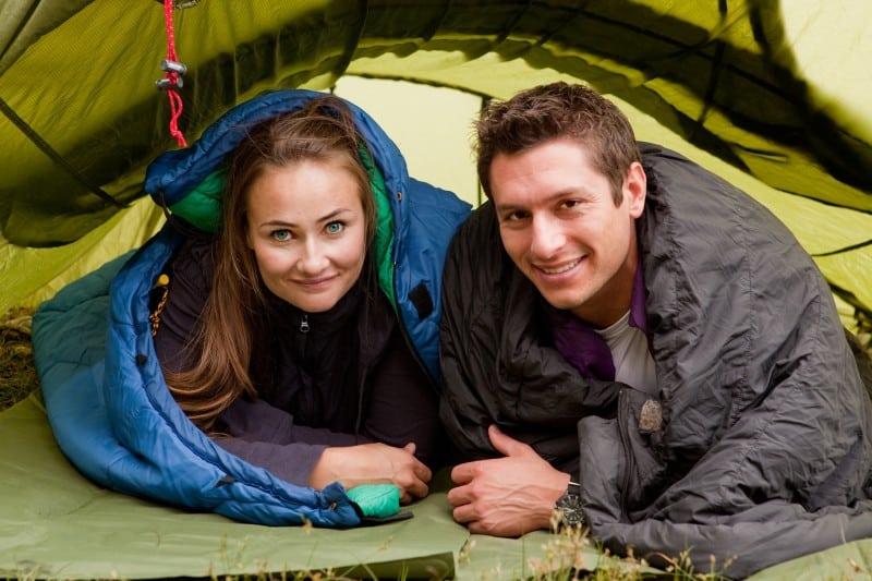 a couple in a sleeping bag