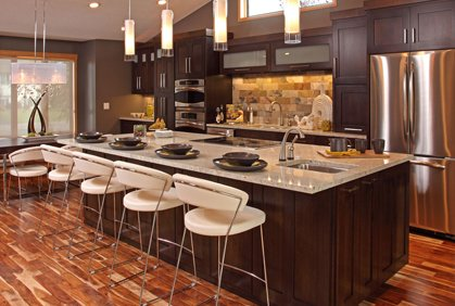 Beautiful kitchen to entertain with chairs