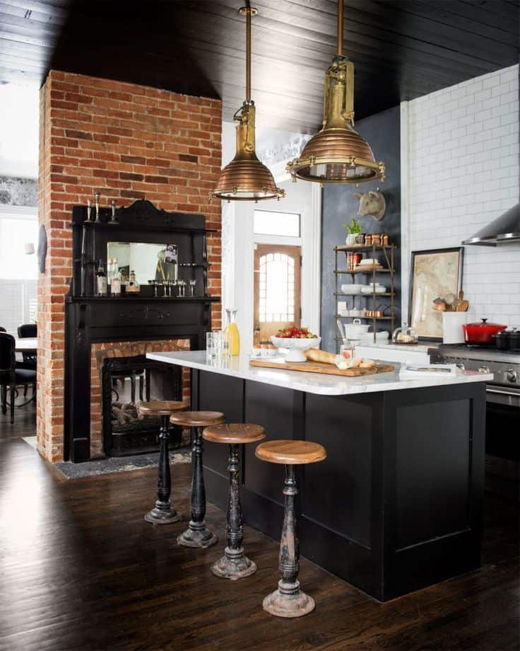 Country kitchen with brick and fireplace (by domino.com)