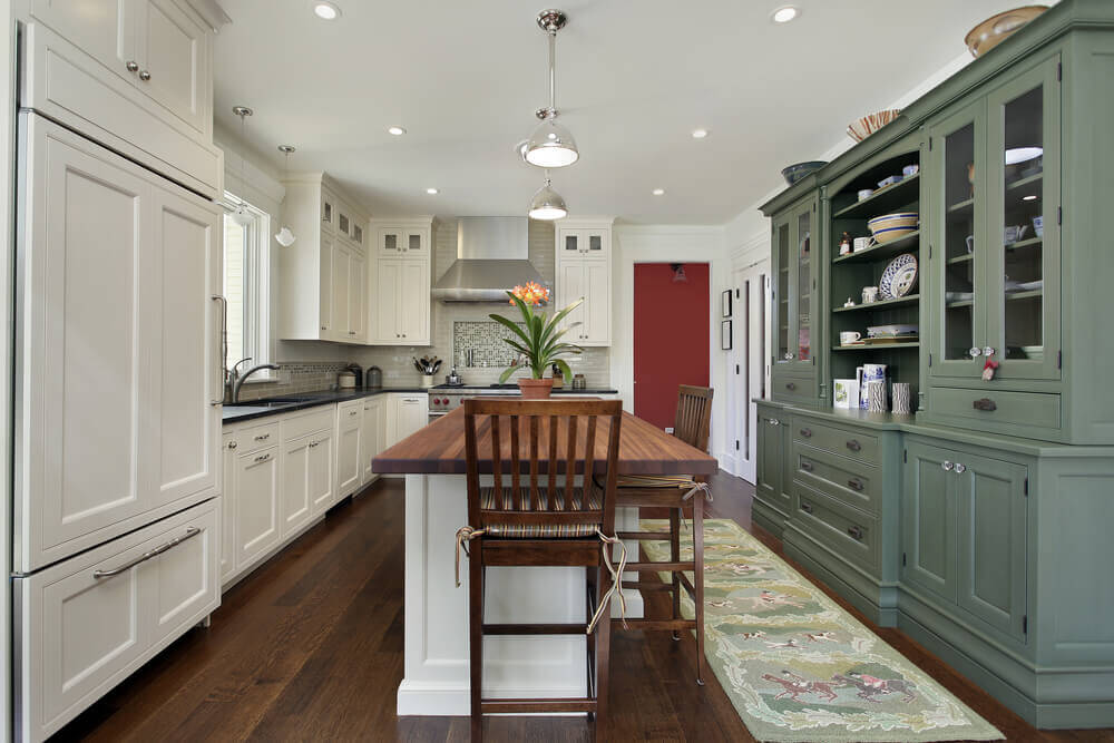 Custom kitchen with wooden cooking island and dark recycled countertops
