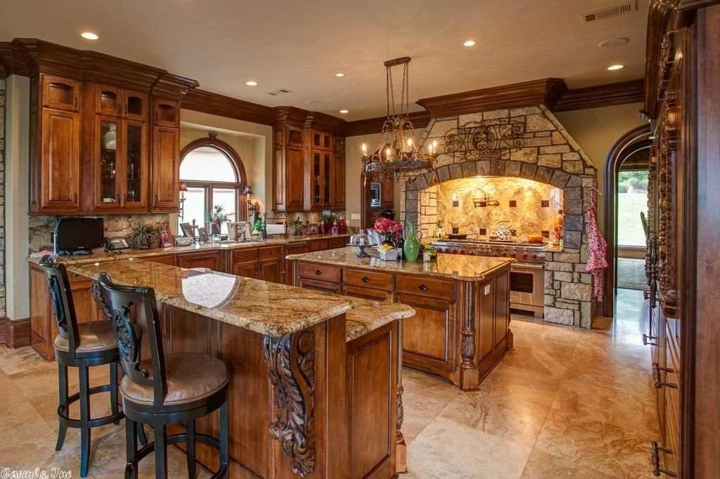 Custom made oak kitchen cabinets with a beautiful stone veneer kitchenette