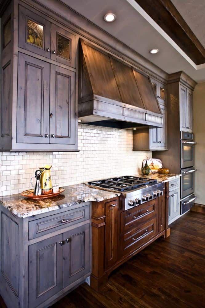 dark cabinets with subway tile (from dakotakitchen.com)