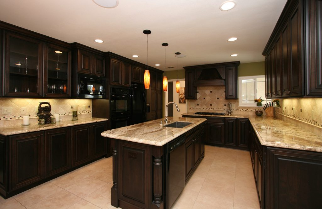 Dark kitchen cabinets with light marble worktop