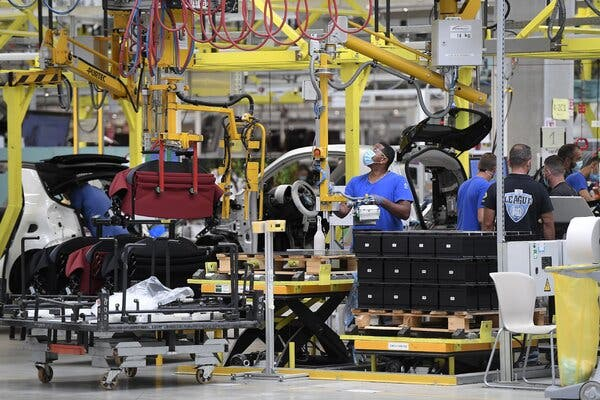 Employees at the assembly line of the Smart car plant in Hambach, France, in July.