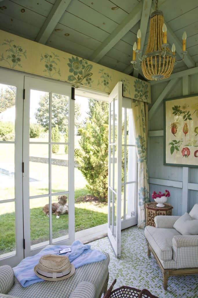 Floor to ceiling windows in a rustic farmhouse (par. deringhall.com)