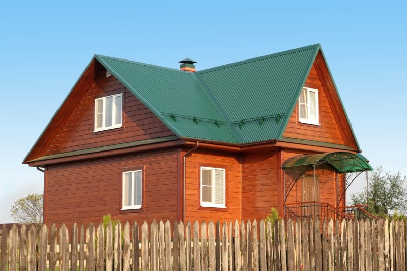 green metal roof on a wooden house
