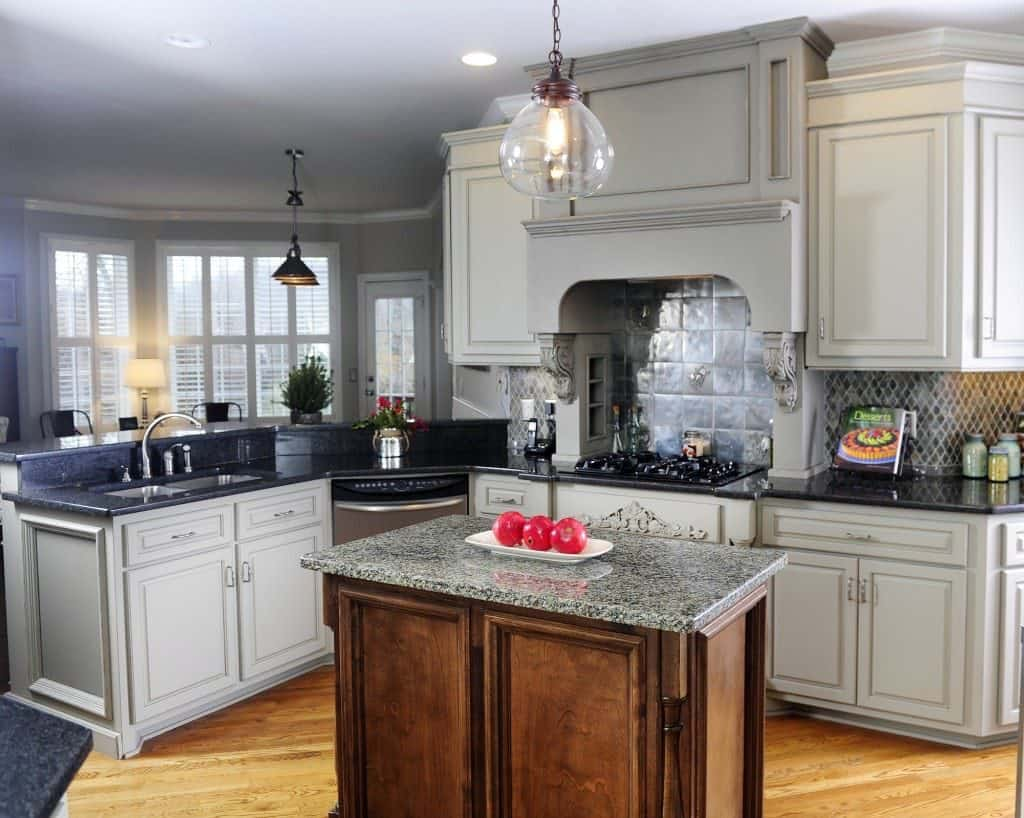 Grey cabinets with striking hood (from bella-tucker.com)