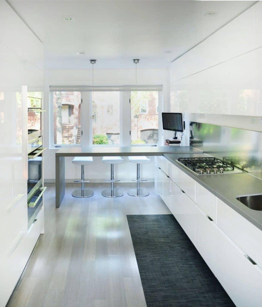 Modern and elegant kitchen with metal back wall (from huntlaudistudio.com)