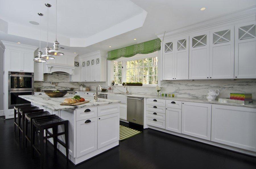 modern white kitchen with dark floor