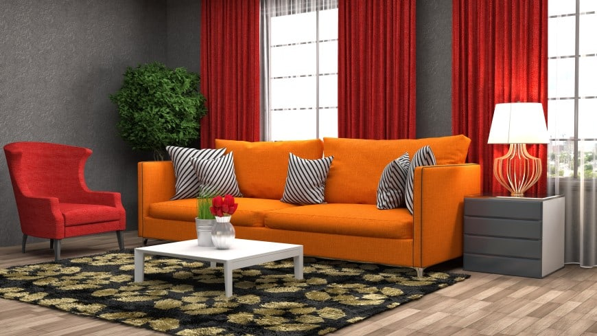 orange sofa and red armchair