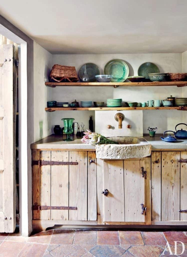 rustic oblong open cabinets (via architdigest.com)