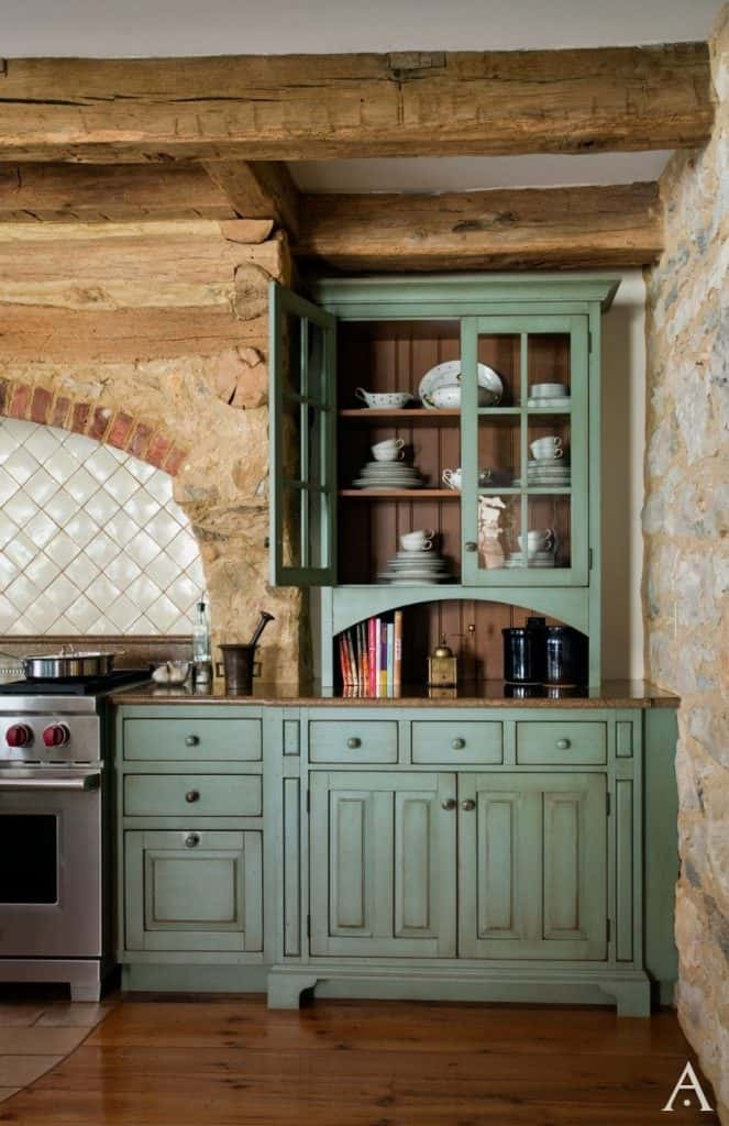Rustic style kitchen cabinets with lined stone walls (by periodarchitectureltd.com)