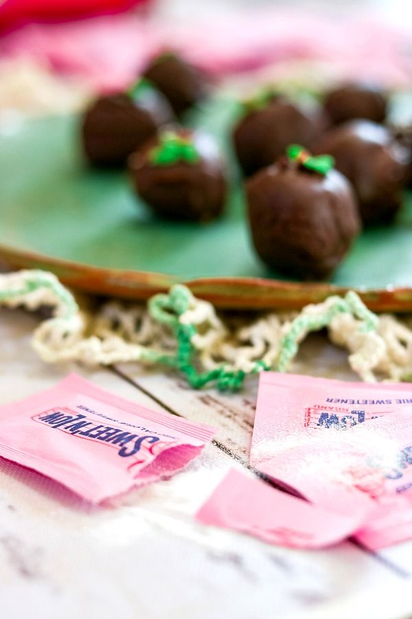 Sweet 'n Low® packaging with chocolate truffles in the background