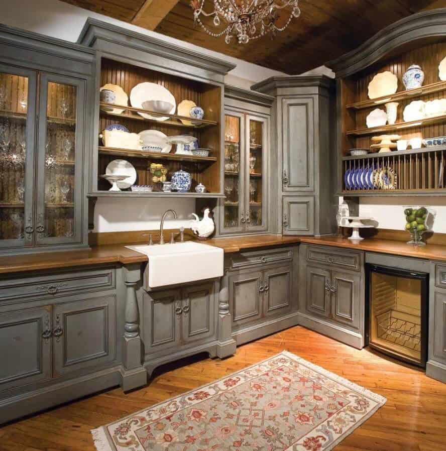 Vintage style grey cabinets with decorative panels (par. dakotakitchen.com)