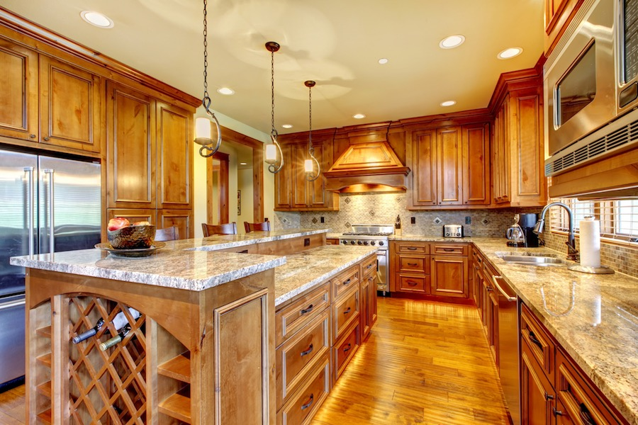 with wooden kitchen and granite worktop.