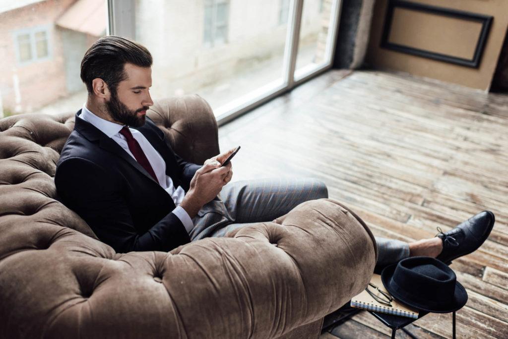 A businessman in an elegant armchair