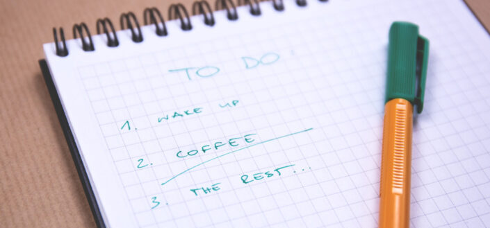 a notebook with a to-do list and a pen.