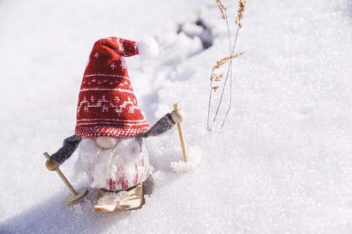 Figure of a felt fairy toboggan on artificial snow