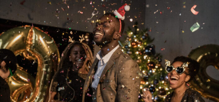 three people at a party surrounded by confetti.