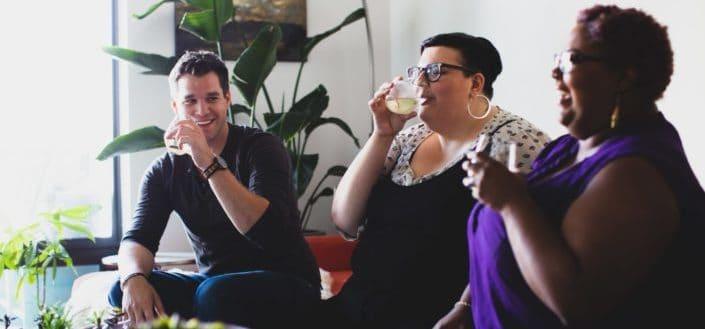three people having a drink